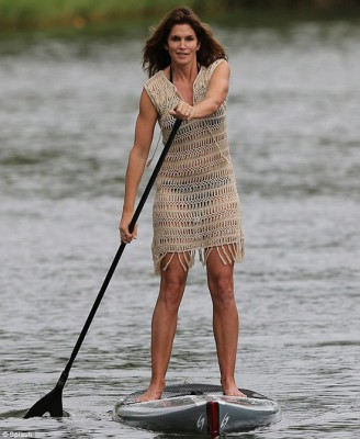 Super Model Cindy Crawford the Paddleboarder. Seems to prefer to stay active instead of lounging lazily