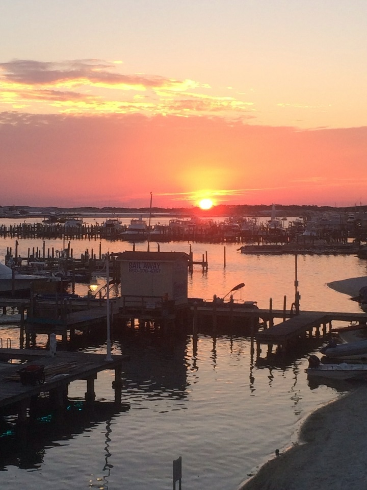 Gorgeous capture of the sun as it sets on Destin Harbor. One of the loveliest reasons to Love Destin, FL..
